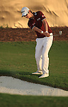 Seung-yul Noh hits his ball from the edge of the bunker on the 18th green during the second round of the Dubai World Championship on the Earth Course at the Jumeirah Golf Estate, Dubai..Picture Fran Caffrey/www.golffile.ie.