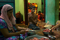 Mohammad Sharif, center, sits with family members inside his home in Chittagong, Bangladesh.
