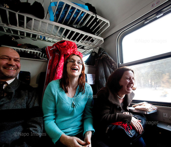 CENTRAL POLAND, FEBRUARY 2012:.Alfred, Meggi, Zosia in train from Warsaw. They commute from Skierniewice, Zyrardow and Lodz. About 500 thousand people commute everyday from other towns and villages to work in the Polish capital..(Photo by Piotr Malecki / Napo Images)..Luty 2012:.Alfred, Megi, Zosia w pociagu z Warszawy. Codziennie dojezdzaja do pracy ze Skierniewic, Zyrardowa i Lodzi. Okolo 500 tysiecy osob dojezdza codziennie z innych miast do pracy w Warszawie.  .Fot: Piotr Malecki / Napo Images