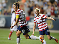 Chester, PA - Sunday, May 27, 2012: Abby Wambach celebrates with Megan Rapinoe (15) after scoring a goal. The USWNT defeated China 4-1 during an international friendly match at PPL Park.