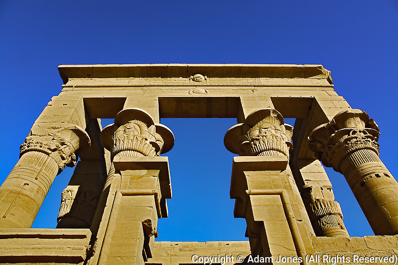 Skyward view of columns, Temple of Philae, on Agilika, an island in the Nile River, near Aswan, Egypt.