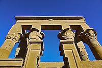 Skyward view of columns, Temple of Philae, on Agilika, an island in the Nile River, near Aswan, Egypt.