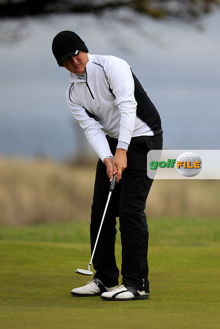 Jamie Rutherford (ENG) takes his putt on the 2nd green during Sunday's Round 4 of the 2013 Irish Amateur Open Championship at The Royal Dublin Golf Club, 12th May 2013..Picture: Eoin Clarke www.golffile.ie.