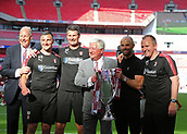 27th May 2018, Wembley Stadium, London, England;  EFL League 1 football, playoff final, Rotherham United versus Shrewsbury Town; Rotherham United manager Paul Warne, Rotherham United  First Team/Development Coach Matt Hamshaw, Rotherham United Assistant Manager Richie Barker and Goalkeeping Coach Mike Pollitt poses alongside Rotherham United chairman Tony Stewart with the EFL League 1 trophy