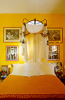 The warm yellow colour scheme creates a cheerful mood in this guest bedroom