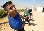 "Members of the ""Tug of War"" team of the northern Israeli Druze village of Julis, practice for the upcoming Israeli national championship in the village stadium Wednesday, June 3, 2009. The national championship will be held on June 11th. Photo By: Moran Mayan / JINI"
