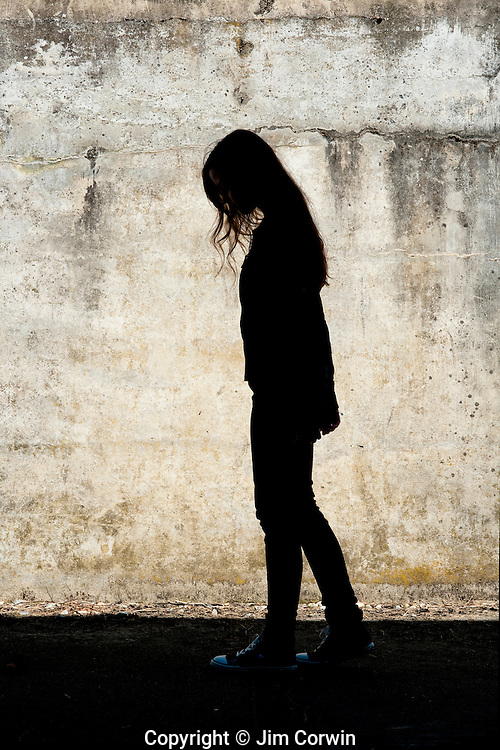 Portait of girl walking in front of a cement wall at Fort Casey State Park Whidbey Island Washington State