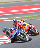 16.06.2013 Barcelona, Spain. Aperol Grand Prix of Catalonia. Picture show Jorge Lorenzo (Yamaha), Dani Pedrosa (Honda) and Marc Marquez (Honda) in action during Moto GP Racing  at Circuit de Catalunya