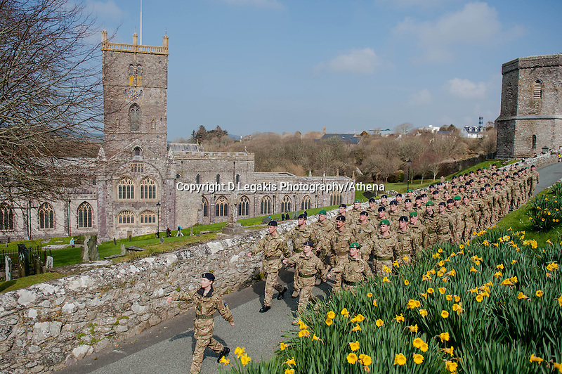 Wednesday 26 March 2014<br /> Pictured: 236 Signal Squadron make their way past St.Davids Cathedral <br /> Re: 236 Signal Squadron ( part of 14 Signal regiment who are based at Cawdor Barracks in Brawdy Parade through the streets of  St.Davids Pembrokeshire led by Haverfordwest Air Training Corps Band and are then Presented with medals