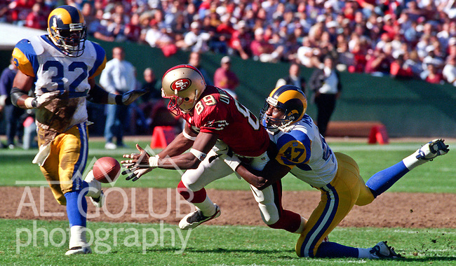 San Francisco 49ers vs. St. Louis Rams at Candlestick Park Sunday, October 12, 1997.  49ers beat Rams  30-10.  St. Louis Rams defensive back Ryan McNeil (47) keeps San Francisco 49ers wide receiver Iheanyi Uwaezuoke (89) from catching pass.