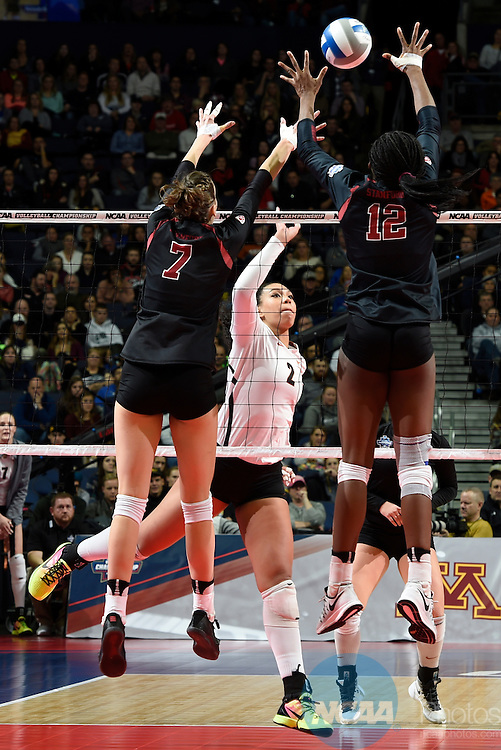 COLUMBUS, OH - DECEMBER 17:  Ebony Nwanebu (2) of the University of Texas attempts a kill against Ivana Vanjak (7) and Inky Ajanaku (12) of Stanford University during the Division I Women's Volleyball Championship held at Nationwide Arena on December 17, 2016 in Columbus, Ohio.  Stanford defeated Texas 3-1 to win the national title. (Photo by Jamie Schwaberow/NCAA Photos via Getty Images)