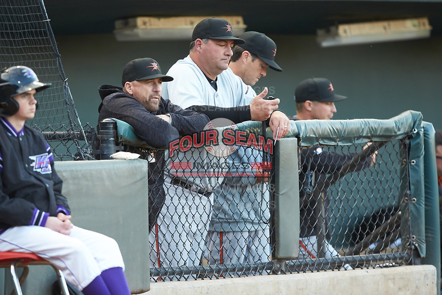 Frederick Keys manager Ryan Minor (center) holds a stop watch during the game against the Winston-Salem Dash at BB&T Ballpark on April 26, 2019 in Winston-Salem, North Carolina. The Keys defeated the Warthogs 7-0. (Brian Westerholt/Four Seam Images)