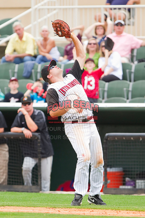 Dan Black #40 of the Kannapolis Intimidators catches a foul pop fly during the game against the West Virginia Power at Fieldcrest Cannon Stadium on April 20, 2011 in Kannapolis, North Carolina.   Photo by Brian Westerholt / Four Seam Images