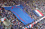 23 June 2006: France fans unfurl a large France flag and an even larger France team jersey before the game. Togo played France at the RheinEnergie Stadion in Cologne, Germany in match 45, a Group G first round game, of the 2006 FIFA World Cup.
