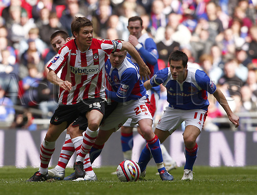 28/03/2010. Saints' captain Dean Hammond (14) is pursued by Adam Clayton (25) and the Carlisle captain Adam Thirlwell (11). Southampton v Carlisle United. Johnstone's Paint Trophy Final at Wembley Stadium, London, England, UK