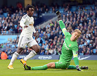 Picture by Howard Roe/AHPIX.com. Football, Barclays Premier League; <br /> Manchester City v Swansea City ;22/11/2014 KO 3.00 pm <br /> Etihad Stadium;<br /> copyright picture;Howard Roe;07973 739229<br /> Swansea's   Wilfred Bony beats    Manchester's Joe Hart to score the opening goal of the game