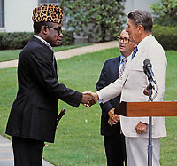 Washington DC., USA, September 23, 1984<br /> President Ronald Reagan shakes hands with President Mobutu Sese Seko of Zaire at the South Lawn as they deliver remarks after their meeting in the Oval Office Credit: Mark Reinstein/MediaPunch