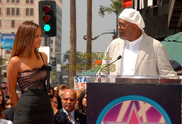 HALLE BERRY & SAMUEL L. JACKSON.Halle Berry is honored with a Star on The Hollywood Walk of Fame on Hollywood Blvd. infront of The Kodak Theatre in Hollywood, California, USA, on April 03rd 2007.half length tight black pencil skirt sheer top bow one shoulder strap white hat cap top jacket suit.CAP/DVS.©Debbie VanStory/Capital Pictures