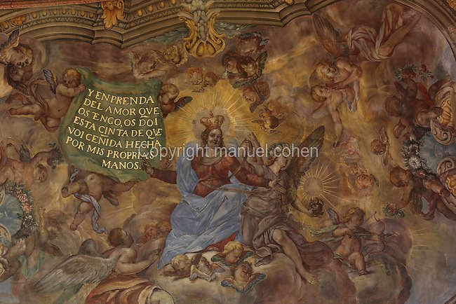 Ceiling fresco of the Virgin in heaven taking off her girdle, probably by Dionis Vidal, 1670-1719, in the presbytery of the Capella de la Santa Cinta, built 1672-1725 in Baroque style, in the Cathedral of St Mary, designed by Benito Dalguayre in Catalan Gothic style and begun 1347 on the site of a Romanesque cathedral, consecrated 1447 and completed in 1757, Tortosa, Catalonia, Spain. The cathedral has 3 naves with chapels between the buttresses and an ambulatory with radial chapels. Picture by Manuel Cohen