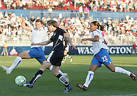 Sonia Bompastor #8 of the Washington Freedom sends over a cross past Amy LePelbet #6 of the Boston Breakers during a WPS match at the Maryland Soccerplex, in Boyd's, Maryland, on April 18 2009. Breakers won the match 3-1.
