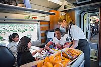 Spain, Costa Brava, Catalonia, Tossa de Mar. Renfe trains. On board staff serving breakfast. All model released.