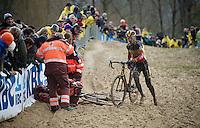 Klaas Vantornout (BEL/Sunweb-Napoleon Games) runs around crashed teammate Michael Vanthourenhout (BEL/Sunweb-Napoleon Games)<br /> <br /> Duinencross Koksijde WorldCup 2015