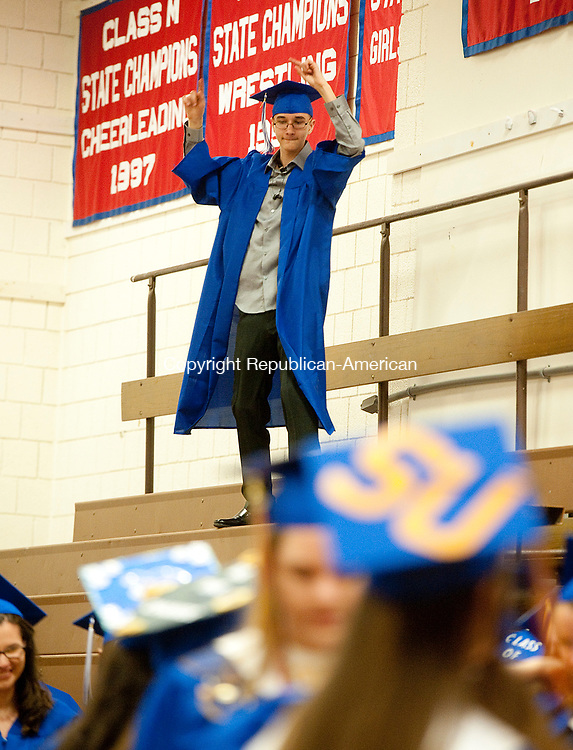 WOODBURY,  CT-061717JS13- Graduates Brian Andrews dances on the bleachers prior to graduation ceremonies Saturday at Nonnewaug High School in Woodbury. <br /> Jim Shannon Republican-American