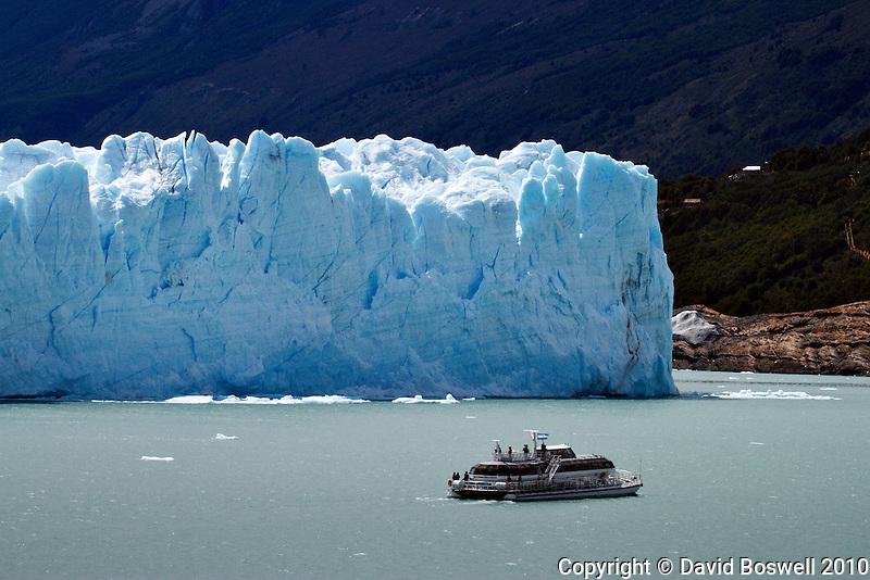 A sightseeing boat nears Glacier Perito Moreno in Parque Nacionales los Glaciares, Argentina.