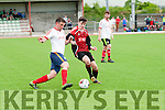 Joseph Diggins (AC Athletic) in action with Neil Cannon (CSKA,Tralee) in the Denny's Div 1 A Final at Mounthawk Park,Tralee on Sunday.