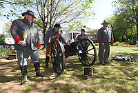 NWA Democrat-Gazette/FLIP PUTTHOFF <br /> BATTLE OF FAYETTEVILLE REMEMBERED<br /> Civil War actors Scott Boehm (from left), Bob Underdown, Terewa Watkins and Martin Bradford perform Saturday April 15 2017 a cannon drill during a program commemorating The Battle of Fayetteville. Events at Headquarters House on East Dickson Street included artifact displays, Civil War era music and dance, cannon drills and a commemoration ceremony. The Battle of Fayetteville was fought April 18, 1863. Headquarters House served as a headquarters of Union and Confederate troops at different times during the Civil War.