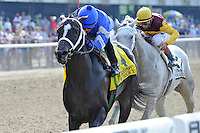 It's Tricky (no. 4), ridden by Eddie Castro and trained by Kiaran McLaughlin, wins the  44th running of the grade 1 Ogden Phipps Handicap for fillies and mares three years old and upward on May 28, 2012 at Belmont Park in Elmont, New York.  (Bob Mayberger/Eclipse Sportswire)