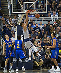 Nevada forward Trey Porter (15) dunks the ball against South Dakota State in the second half of an NCAA college basketball game in Reno, Nev., Saturday, Dec. 15, 2018. (AP Photo/Tom R. Smedes)