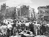 May 1949, First Independence Day Parade in Jerusalem. The parade is passing along King George Street with the passers-by straining to see.