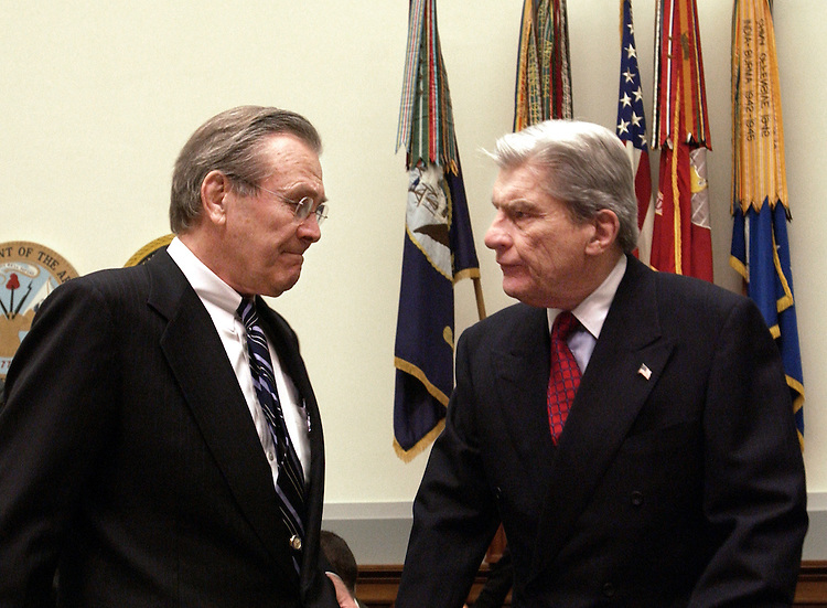 Defense Secretary Donald Rumsfeld and Chairman John Warner, R-VA., during the full committee hearing on the defense authorization request for FY2005 and the Future Years Defense Program.  The hearing was held in the Rayburn House Office Building because of the ricin incident.