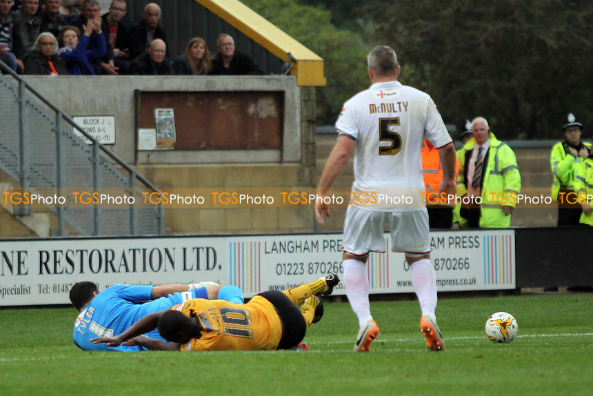 Tom Elliott (Cambridge United) goes in on Mark Tyler (Luton Town) - Cambridge United vs Luton Town - Sky Bet League Two Football at the Abbey Stadium, Cambridge - 20/09/14 - MANDATORY CREDIT: Mick Kearns/TGSPHOTO - Self billing applies where appropriate - contact@tgsphoto.co.uk - NO UNPAID USE