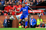 Marcus Rashford of Manchester United challenges Danny Simpson of Leicester City  during the Premier League match at Old Trafford Stadium, Manchester. Picture date: September 24th, 2016. Pic Sportimage