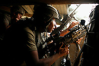 Sergeant Joshua McDonough and Specialist Miguel Gutierrez fire grenades and automatic weapons from the 'Restrepo' bunker after coming under attack. The position was named after a soldier from 2nd Platoon who was recently killed by insurgents..Battle Company, 2nd Battalion Airborne of the 503rd US Infantry are undergoing a 15 month deployment in the Korengal Valley, epicentre of the war and scene of fierce fighting with the Taliban...