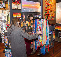 People visit The Holiday Art Fair at the Madison Museum of Contemporary Art (MMoCA) in downtown Madison, Wisconsin on Saturday, November 21, 2015