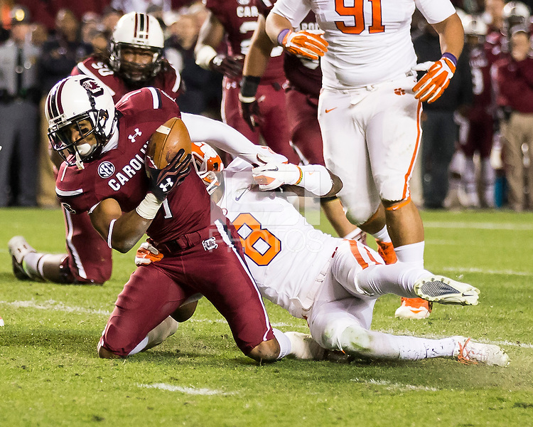 The tenth ranked South Carolina Gamecocks host the 6th ranked Clemson Tigers at Williams-Brice Stadium in Columbia, South Carolina.  USC won 31-17 for their fifth straight win over Clemson.  South Carolina Gamecocks wide receiver Damiere Byrd (1), Clemson Tigers cornerback Darius Robinson (8)