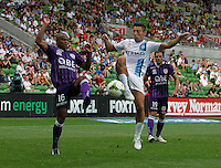 Sidnei fight for the ball with Robert Koren  during the  A-League soccer match between Melbourne City FC and Perth Glory at AAMI Park on February 22, 2015 in Melbourne, Australia.