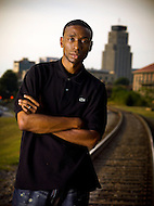 Hip Hop Producer 9th Wonder stands on the railroad tracks that run into his home town of Durham North Carolina.