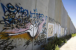 A Graffiti is seen on the Israel's separation barrier in the West Bank city of  Ramallah on Sept. 16, 2010. US Secretary of State Hillary Rodham Clinton arrived to the Palestinian Authority's headquarters in the West Bank to confer with Palestinian President Mahmoud Abbas. Photo by Eyad Jadallah
