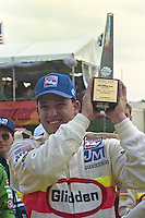 Tony Stewart celebrates after winning the IRL Indy Car race at Walt Disney World Speedway, Lake Buena Vista, FL, January 24, 1998.  (Photo by Brian Cleary/www.bcpix.com)