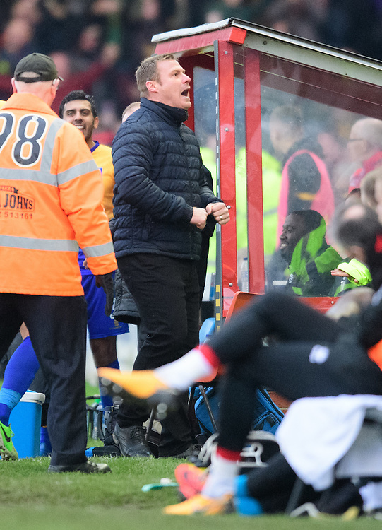 Mansfield Town manager David Flitcroft celebrates, in the direction of Lincoln City fans, after Mansfield Town's Jacob Mellis had scored the equalising goal<br /> <br /> Photographer Chris Vaughan/CameraSport<br /> <br /> The EFL Sky Bet League Two - Lincoln City v Mansfield Town - Saturday 24th November 2018 - Sincil Bank - Lincoln<br /> <br /> World Copyright © 2018 CameraSport. All rights reserved. 43 Linden Ave. Countesthorpe. Leicester. England. LE8 5PG - Tel: +44 (0) 116 277 4147 - admin@camerasport.com - www.camerasport.com