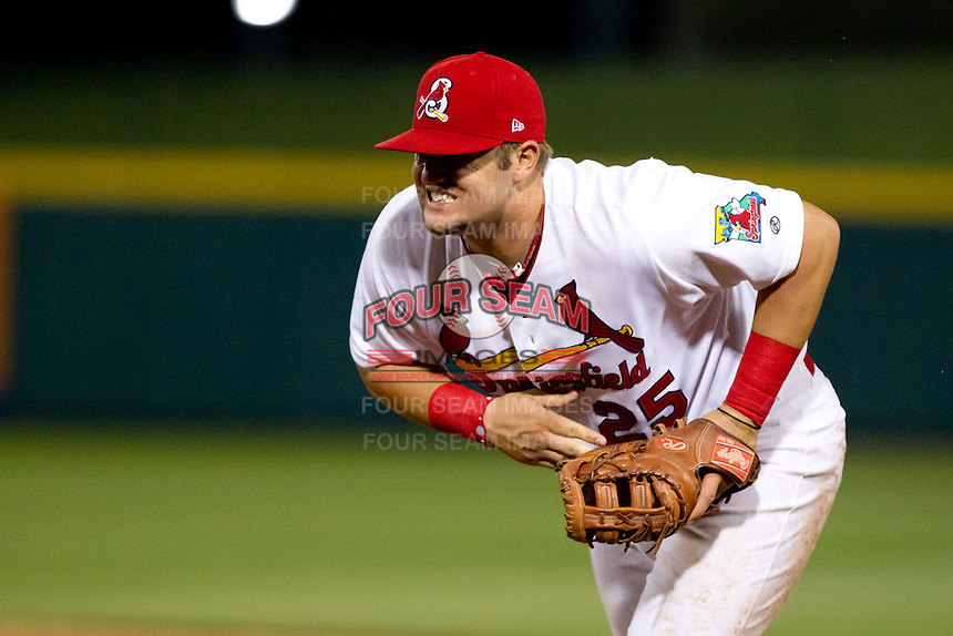 Matthew Adams (25) of the Springfield Cardinals hurries to first base after making a stop on a line drive during a game against the Frisco RoughRiders on April 14, 2011 at Hammons Field in Springfield, Missouri.  Photo By David Welker/Four Seam Images.