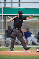 Umpire Zee Zdenek calls a strikeout during a Gulf Coast League game between the GCL Astros and GCL Marlins on August 8, 2019 at the Roger Dean Chevrolet Stadium Complex in Jupiter, Florida.  GCL Marlins defeated GCL Astros 5-4.  (Mike Janes/Four Seam Images)