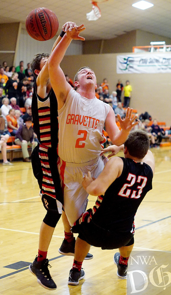 Photo by Randy Moll<br /> Jackson Soule, Gravette junior, attempts a shot over Pea Ridge junior Britton Caudill and Pea Ridge senior Zach Davis during play between the two teams in Gravette on Firday, Jan. 30, 2015.