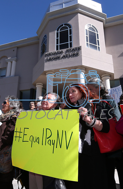 A small crowd gathers on the steps of the Legislative Building in Carson City, Nev., on Monday, Feb. 23, 2015 to help raise awareness of pay inequality. <br /> Photo by Cathleen Allison