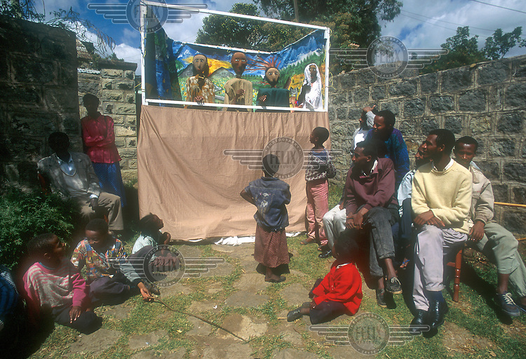 © Giacomo Pirozzi / Panos Pictures..ETHIOPIA..Adults and children watch a puppet show about AIDS and safe sex.