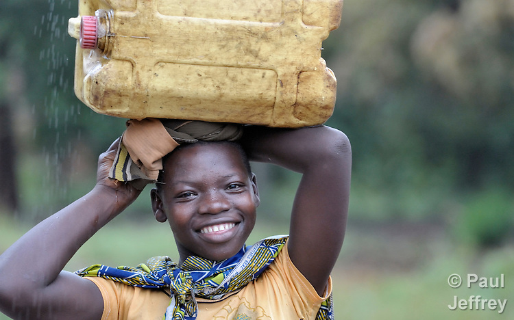 A girl in Riimenze, a village in Southern Sudan's Western Equatoria State, prepares to carry a jerry can of water home from a well. NOTE: In July 2011 Southern Sudan became the independent country of South Sudan.